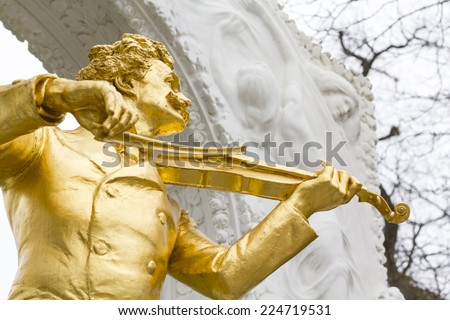 Famous statue of Johann Strauss at Stadtpark in Vienna, Austria. The monument was created by Edmund Hellmer in 1921 and become a popular tourist attraction in Vienna - stock photo