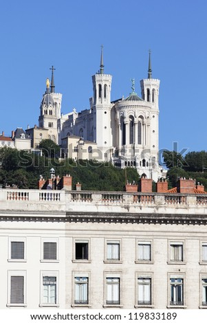 famous statue of Louis XIV and basilica on a background - stock photo