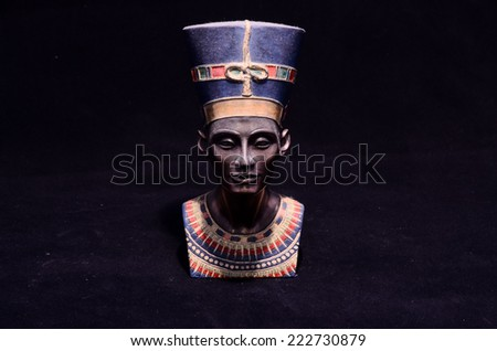 Famous Statuette Bust of Queen Nefertiti Isolated on Black Background - stock photo