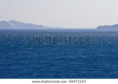 Famous strong northern wind bura blowing over the sea in front of Senj - stock photo