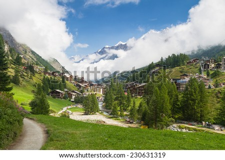 Famous swiss city Zermatt in the valley near the swiss-italian border center of alpine sports. Valais canton, Switzerland - stock photo
