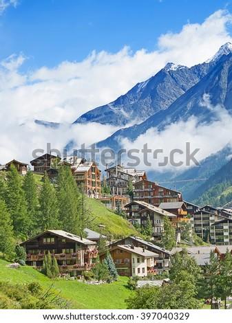 Famous swiss city Zermatt in the valley near the swiss-italian border center of alpine sports - stock photo