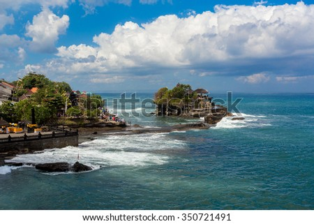 famous Tanah Lot Temple on Sea in Bali Island Indonesia with blue sky and waves - stock photo
