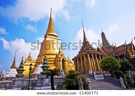 famous temple Phra Sri Ratana Chedi covered with foil gold in the inner Grand Palace - stock photo