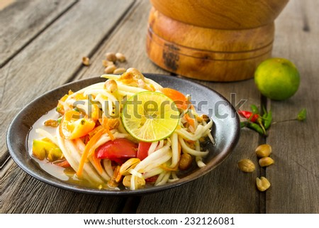 "Famous Thai food,  papaya salad or what we called ""Somtum"" in Thai - stock photo"