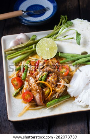 Famous Thai food,  spicy papaya salad with salted crab and fermented fish : somtum - stock photo