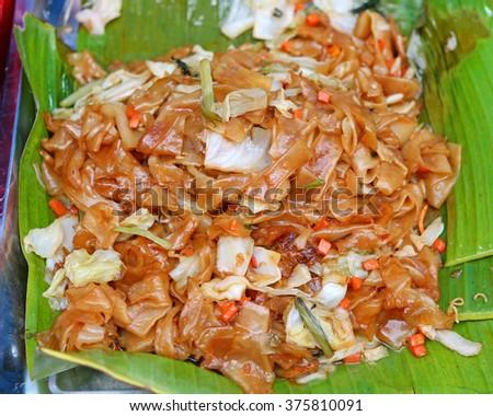 Famous Thai's dish Phad thai, Fried noodle on banana leaf. - stock photo