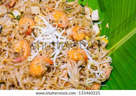 Famous Thai's dish Phad thai. Fried noodle with shrimp on banana leaf. - stock photo