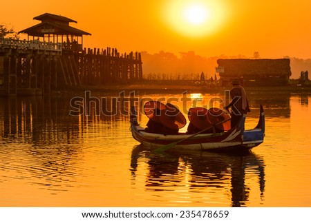 Famous tick bridge at sunset in Myanmar - stock photo