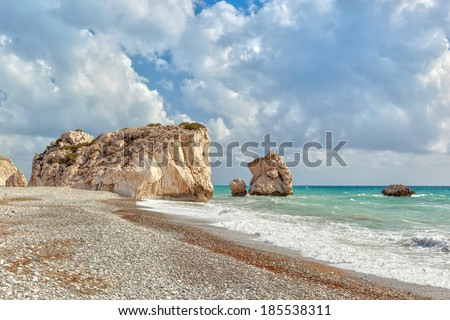 Famous touristic landmark Aphrodite's rock and empty pebble beach Petra tou Romiou at early spring, Cyprus