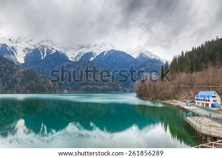 Famous touristic nature landmark Ritsa lake in early spring, Abkhazia