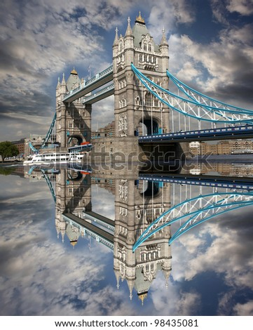 Famous Tower Bridge with boat in  London, UK