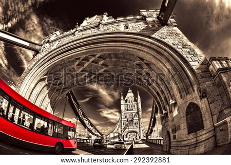 Famous Tower Bridge with red bus in London, England - stock photo