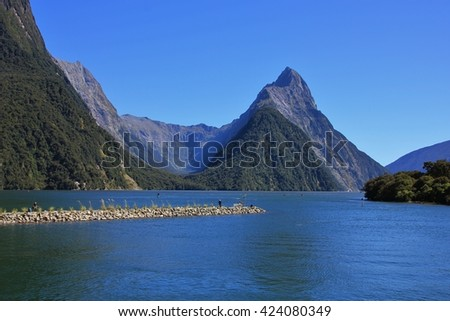 Famous travel destination in New Zealand. Mitre Peak and Milford Sound. - stock photo