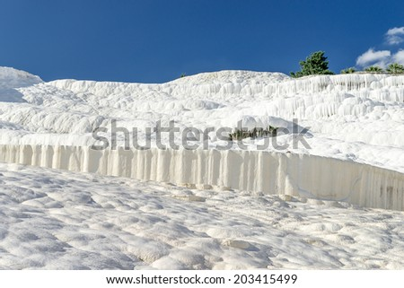 Famous travertine pools and terraces in Pamukkale, Turkey - stock photo