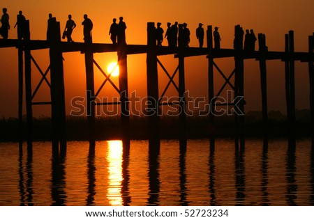 Famous U Bein bridge and people at sunset - stock photo