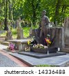 "Famous Ukrainian composer and author  Volodymyr Ivasjuk (""Chervona ruta"" and another 400 songs author) monument on ancient Lychakivskyj cemetery (Lviv City, Ukraine) - stock photo"