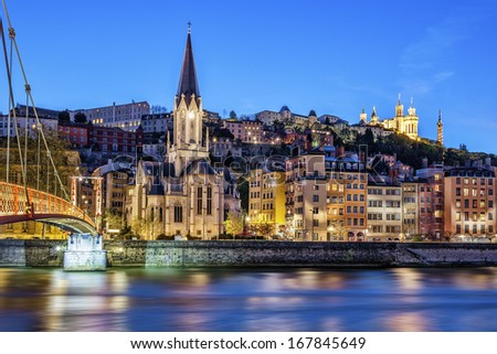 Famous view of Lyon with Saone river at night  - stock photo