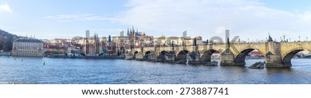 famous view of the prague castle and the charles bridge in prague which every year attracts millions of tourists from all around the world. - stock photo