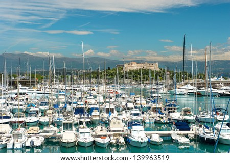 famous village Antibes near Nice, Cannes and Monaco. french riviera. landscape with sailing boats and yachts - stock photo