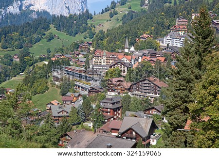 Famous village Wengen in swiss alps - starting point for train tours in the Jungfrau region - stock photo