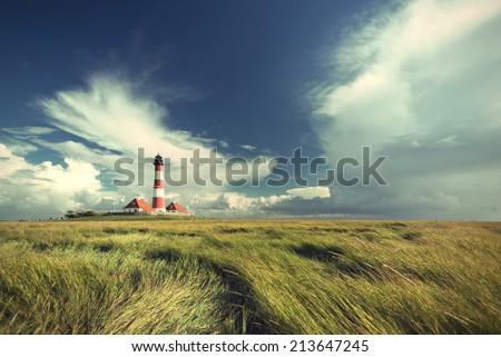 famous Westerhever lighthouse at North Sea coast, Schleswig-Holstein, Germany, Europe, vintage style, Leuchtturm Westerhever an der deutschen Nordseekueste, Nordfriesland, Deutschland, Europa - stock photo