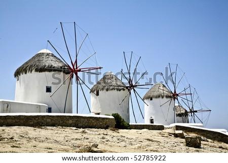 famous windmills of mykonos - stock photo