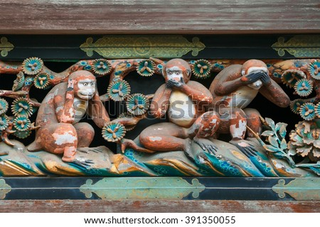 """Famous wood carvings """"see no evil, speak no evil and hear no evil"""" of the three wise monkeys at Tosho-gu wood carvings at a Store House in Nikko Tosgogu Shrine, Japan - stock photo"""