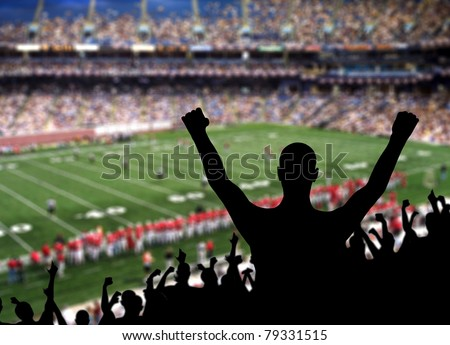 Fan celebrating a victory at a American football game. - stock photo