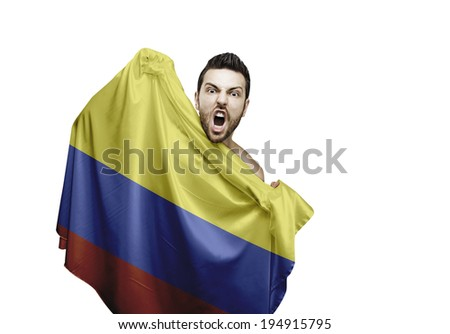 Fan holding the flag of Colombia celebrates on white background - stock photo