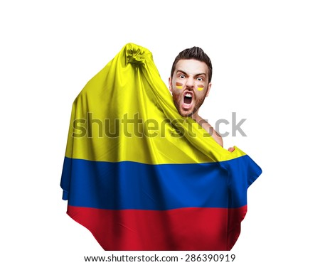 Fan holding the flag of Colombia on white background - stock photo
