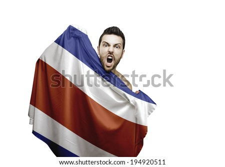 Fan holding the flag of Costa Rica celebrates on white background - stock photo