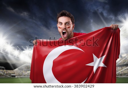 Fan holding the flag of Turkey in the stadium - stock photo