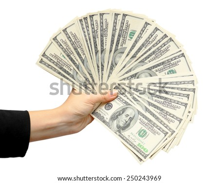 Fan of dollars in a female hand on a white background