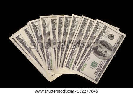 Fan of hundred-dollar banknotes. Isolated on black. - stock photo