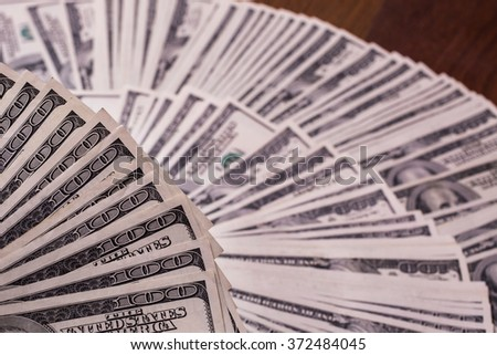 fan of money, a fan of new hundred dollar bills, hundred dollar bills face, thirst for wealth, detail, renting, pocket money, money background, millionaire, money in hand, taking money - stock photo