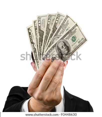 Fan of money in the hands in front of face