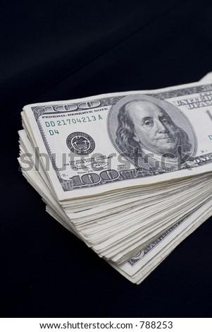 fan of money on black - stock photo