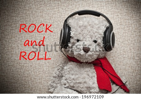 fan of rock and roll in the headphones - stock photo