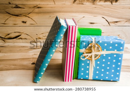 fan-shaped arrangement of brightly colored books - stock photo