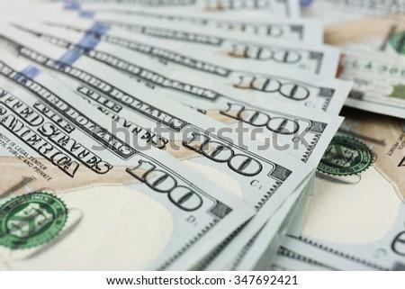 Fan shaped hundred dollars cash money as background - stock photo