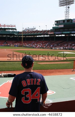 Fan waiting for autographs at Fenway Park. - stock photo