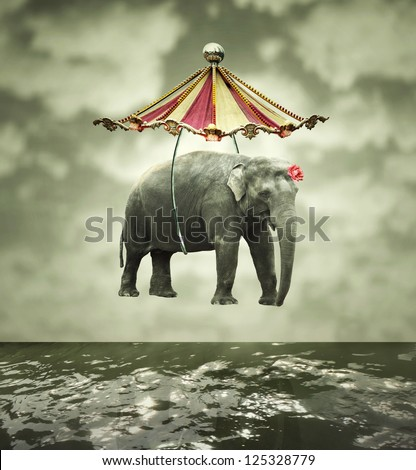 Fanciful and artistic image that represent a flying elephant with circus tent above the water - stock photo