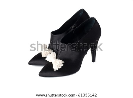 fancy black women shoes with white knots white isolated