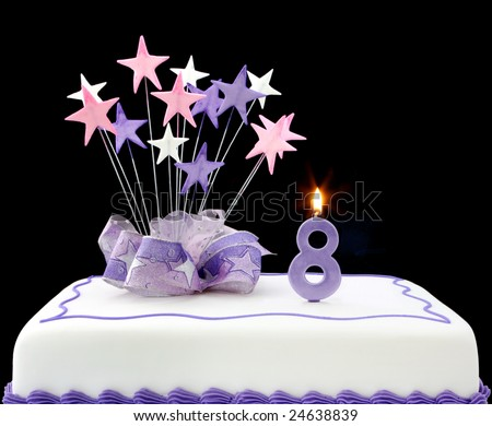 Fancy cake with number 8 candle.  Decorated with ribbons and star-shapes, in pastel tones over black background. - stock photo