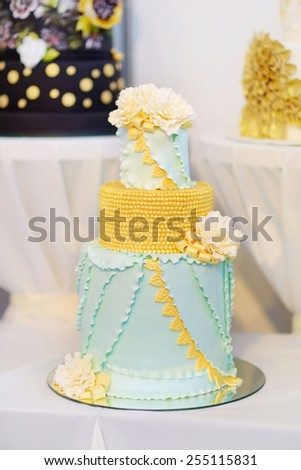 Fancy delicious green wedding cake decorated with flowers  - stock photo