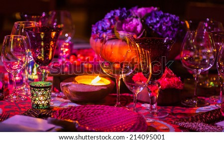 Fancy dinner table setting with candle light. - stock photo