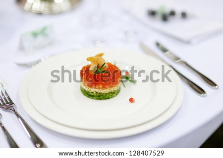 Fancy fish dish on a white plate - stock photo