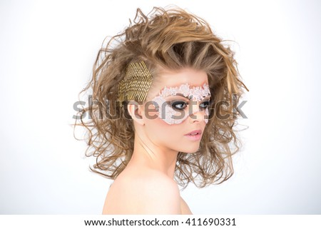Fancy hairstyle and artistic makeup - stock photo