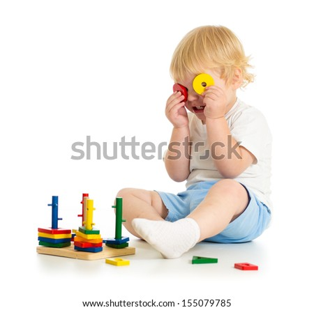 fancy kid making spectacles from toy parts - stock photo
